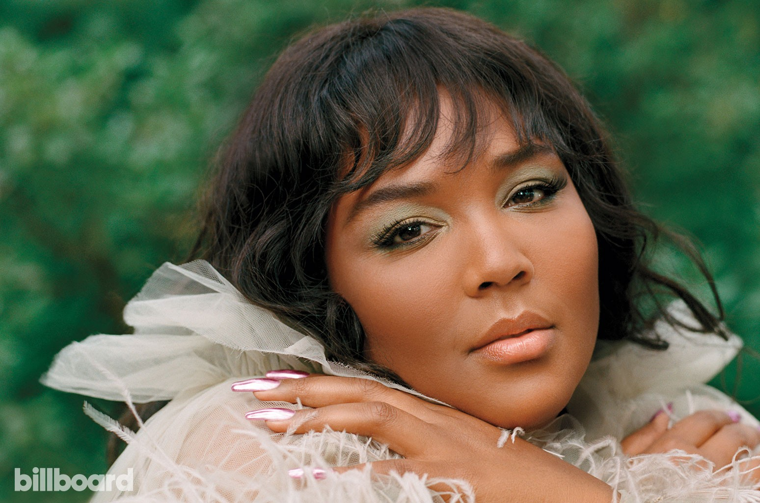 HOW TO Get Sleek & Sassy Strands Like Lizzo, According to Her Hairstylist